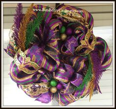 Check out this item in my Etsy shop https://www.etsy.com/listing/220895342/mardi-gras-wreath-mardi-gras-decor