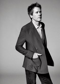 From the February 2013 issue    Double-breasted polyamide jacket ($1,750) by Giorgio Armani; cotton shirt ($248) by John Varvatos; cotton jeans ($168) by AG Adriano Goldschmied.