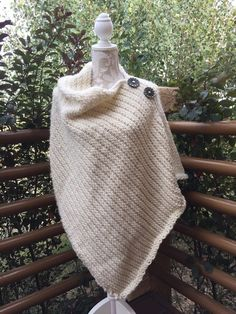 """This is my favorite poncho because of its soft and warm fabric. The poncho is knit on a 1/2"""" gauge loom with at least 83 pegs. I used the CindWood 90 peg small afghan loom for this poncho. Seven skeins of Loops & Threads Charisma yarn (#5 bulky) are needed to complete this poncho."""