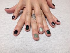 Black with dark green glitter stripes and shamrocks with light green glitter accent nails  Oasis Salon and Spa Mill Hall Pa (570)726-6565