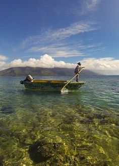 """Natural Park of the Coral Sea - largest MPA. A fisherman paddling his boat in New Caledonia. alt=""""© Conservation International/photo by Lily Clarke"""