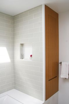 Designer Todd Davis worked two smart space-creating solutions into this small San Francisco bathroom remodeling project. A built-in cabinet conceals storage for linens and toiletries without adding any visual clutter, while a small niche in the shower space offers a spot to leave soap and shampoo without taking up much real estate.