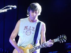 Tom Scholz playing guitar