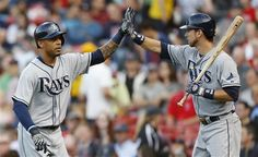 Tampa Bay Rays' Desmond Jennings, left, celebrates his solo home run with teammate Ben Zobrist in the first inning of a baseball game against the Boston Red Sox in Boston, Wednesday, June 19, 2013. (AP Photo/Michael Dwyer)