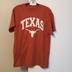 Men's University of Texas tshirt. Size large. Men's University of Texas UT tshirt. No tags, most likely a size large (my husband's size). Maybe worn once. Excellent condition. Tops Tees - Short Sleeve