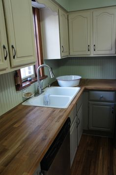 Wood counter tops in the kitchen. Fun back-splash idea as well.