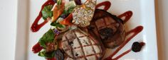 Bacon Wrapped Pork Loin served with a rosemary pepitas brittle over a a fig port reduction as well as a wilted salad of cabbage, carrot, and arugula. Restaurant Specials, Pork Loin, Bacon Wrapped, Arugula, Fig, Carrots, Steak, Cabbage, Chicken