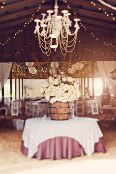 Gorgeous rustic wedding with oak barrel and chandelier #wedding #urquidlinen