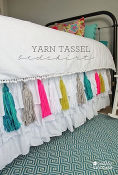 To make all you have to do is sew some colorful tassels onto a plain white bedspread and you have instant cuteness!