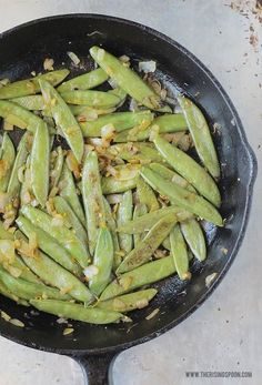 A simple and healthy vegetable recipe featuring fresh or frozen sugar snap peas quick cooked on the stove top with onion, garlic, orange zest, and seasonings. If you enjoy vegetables like green beans and snow peas for their crispness, and carrots for their sweetness, then you'll love this fast sugar snap peas recipe!