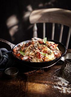 Spaghetti with tomato, bacon, caper and basil