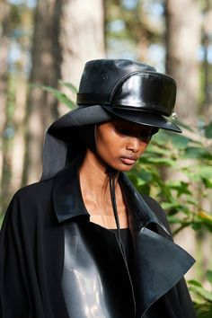 Pouch bags (fanny pack) attached to the hats at Burberry Spring 2021 #LFW