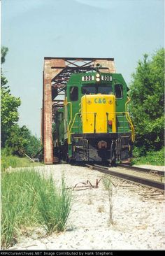 CAGY 808 leads Columbus bound train off Tenn-Tom bridge in 1994 Description: Photo Date: 10/10/1994 Location: Columbus, MS Author: Hank Stephens Categories: Locomotives: CAGY 808(CF7)