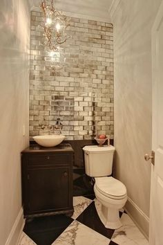 Add drama to a small space with a chandelier and subway tile.