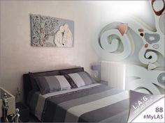 #MyLAS Welcome to Paola's #home! #bedroom #design #homeinspiration #interiors http://www.laserartstyle.it/home/gallery/my-las/ SACRED WALL SCULPTURES   CODE: SI-173   SIZE: 125x70 cm   COLOUR: silver and light grey application - DECORATION: brick red