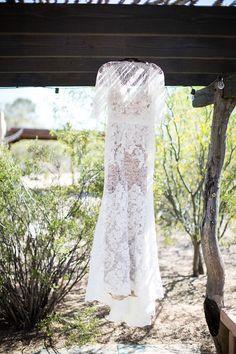 Shannon & Luke's Spring in the Desert Wedding // Photography: Even Robold Photography // Wedding Planning: Lindsay Bishop Events // Venue: San Pedro Chapel #laceweddingdress #tucsonweddingvenue #sanpedrochapel #desertwedding