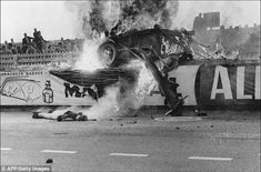 The body of French driver Pierre Levegh lies on the ground after his Mercedes crashed at L...