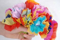 Lollipops with tissue paper flowers. Cute idea for Mother's Day with poems attached