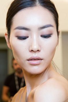 #Asian makeup- bold #brows, pinkish eyeshadow, thick black liner and nude lips