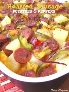 Sausage, potatoes, bell peppers and onions oven-roasted with garlic powder in an olive oil.