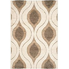 @Overstock - This power-loomed shag area rug easily matches a variety of interior decors, thanks to its use of a cream background and smoke accents. Polypropylene and canvas materials make the rug durable.http://www.overstock.com/Home-Garden/Hand-woven-Ultimate-Cream-Smoke-Shag-Rug-8-x-10/5665235/product.html?CID=214117 $190.14