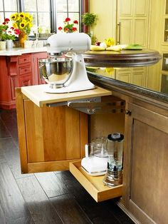 I need this! The mixer sits on the shelf in the cabinet and pops up when needed. There is also a plug inside the cabinet. Genius.