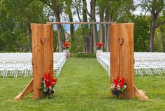 A rustic barnwood entrance trimmed with lucky horseshoes welcomes the wedding party | The Powder Horn Golf Community, Sheridan, WY | Photo by David Swift