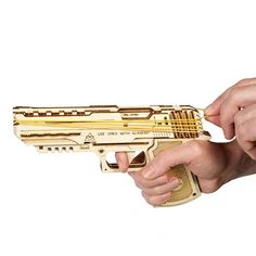 "Shoot rubber band ""bullets"" with this DIY handgun model. Includes safety switch, rubber bands and fixture for adding a torch. Rubber Band Gun, Safety Switch, Secret Compartment, Technology Design, Airsoft Guns, Diy Kits, Hand Guns, Wolf, Gadgets"