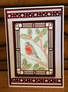 I made this card with the Creative Expressions, Sue Wilson stained glass robin die. The robin and holly have been made using parchment paper and glossy accents for the red areas. I haven't used a sentiment yet because I think this could make a winter birthday or a Christmas card