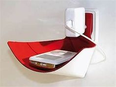 Pod for your iPhone. It lies there while you charge. Cool travel gadget - Bing Images