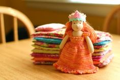Miniature Waldorf doll: Princess and the Pea (sewn mattresses and knitted clothes).