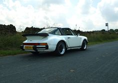 One of only 56 Targa Turbo's built with fewer than 61000 miles travelled. Porsche 930 Turbo, Game Changer, Classic White, Auction, Cars, Gallery, Classic Cars, Roof Rack, Autos