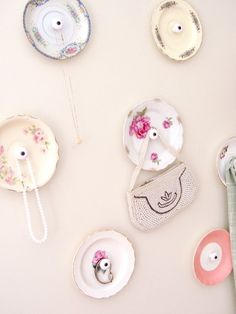 vintage china saucers become ornate storage hooks...