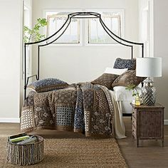 I love the woodblock look of the quilt.  The company store also has navy woodblock sheets.  A painted white bed frame would really show off this quilt.  The jute rug is a nice touch.