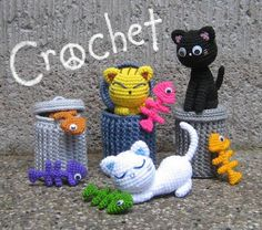 How adorable are these alley cats with their trash cans & fish bones?!  I have to learn how to crochet these, they would make awesome cat toys!!!
