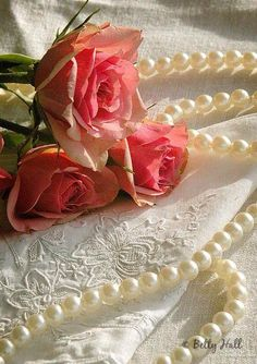 Pink roses and pearls.˚