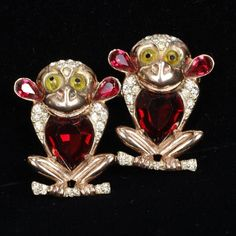 <b>Coro Duette; sterling silver vermeil Monkey pair with faceted red crystal bellies.</b> H 1 1/2""