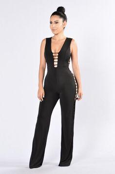- Available in Black - Wide Leg Jumpsuit - Open Sides - Low V Neckline - Skinny Strap Design - V Key Hole Back - Sleeveless - Made in USA - 96% Polyester 4% Spandex