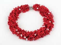 handcrafted gorgeous 7 strand real pearl and red coral necklace.