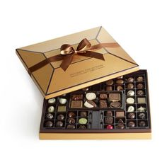 The Ultimate Collection from Godiva is sure to be a hit this holiday season with an impressive assortment of gourmet Godiva chocolates for everyone to enjoy. Luxury Chocolate, Chocolate Brands, Chocolate Shop, I Love Chocolate, Chocolate Lovers, Christmas Chocolate, Chocolate Box Packaging, Chocolate Gift Boxes, Chocolate Sweets