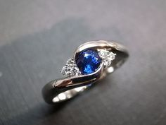 Diamonds Wedding Ring with Blue Sapphire in 14K White Gold. $840.00, via Etsy.