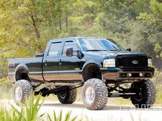 Ford lifted black F-150 truck