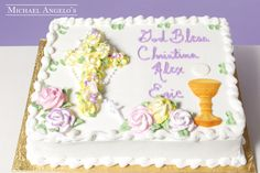 Yellow Cross with Chalace #60Religious This sheetcake is decorated with a sugar chalace and host along with a bed of roses in the shape of a cross. The cake also has a plastic rosary that is placed over the cross. This cake is available in a quarter sheet, half sheet or full sheet.