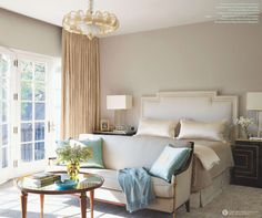 Neutral bedroom with pops of pale blue and gold