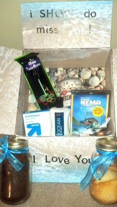 Kind of. 4 cakes in a jar with icing and forks. Ocean lotion from Bath and Body Works. Other bathroom And cleaning supplies. And a little whale. Because i 'whaley' love him. Cheesy i know. Bf Gifts, Boyfriend Gifts, Cute Gifts, Gifts For Him, I Care Packages, Deployment Care Packages, Cake In A Jar, Lotion, Care Box