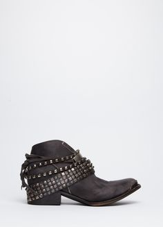 Low-profile boot from Freebird by Steven featuring buckles, studs, and purposeful distressing. Side zip closure.
