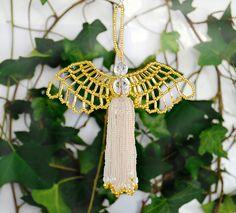 Ariel Angel tassel gold