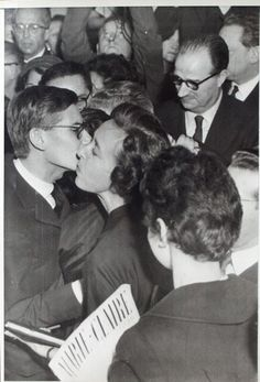 1957 - Yves Saint Laurent kissed after his 1st Dior show