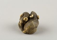 Netsuke of Two Rats Artist: Okatori Date: early 19th century Culture: Japan Medium: Ivory, horn Dimensions: H. 1 in. (2.5 cm); W. 1 9/16 in. (4 cm)