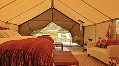 """Visit the Cabanas Cuatrocuatros in Ensenada, Mexico. The short drive down the Baja coast leads you to a wonderment of climates nestled within a vineyard, with access to the ocean just a bit further down the highway. The luxurious """"tents"""" on the property all boast king or queen sized beds, A/C, mini bars, heaters, bathrooms and fireplaces on the indoor and outdoor terraces. In addition to the amazing views from your abode, you have the option of ATV rides, wine tastings and spa treatments."""